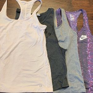 Set of 4 workout tanks. Mixed brands